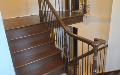 Refinished oak with new wrought iron spindles